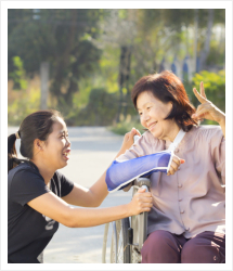 woman assisting old woman on the wheelchair