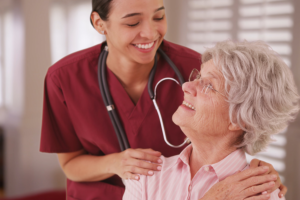 caregiver smiling and old woman smiling